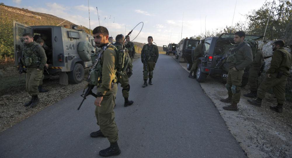 Izraelští vojáci na hranici s Sýrií