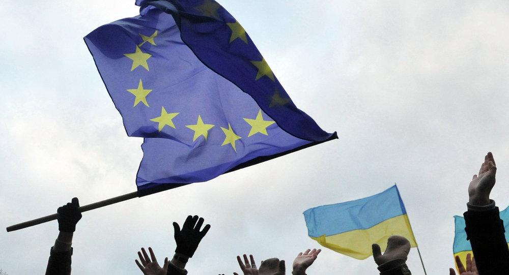 Students wave flags of the European Union and Ukraine