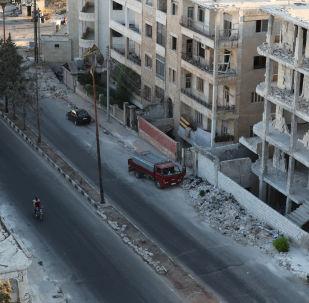 Zničené domy v Idlibu