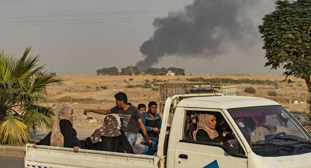Následky tureckého náletu na město Ras al-Ain v provincii Hasaka (9. 10. 2019)