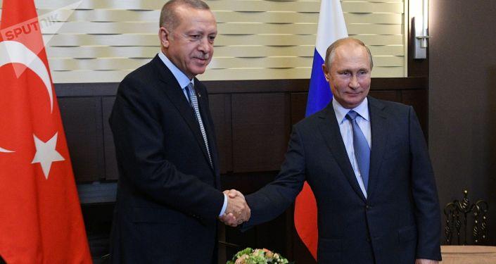 Ruský prezident Vladimir Putin a turecký prezident Recep Tayyip Erdogan během setkání v Soči 22. října 2019