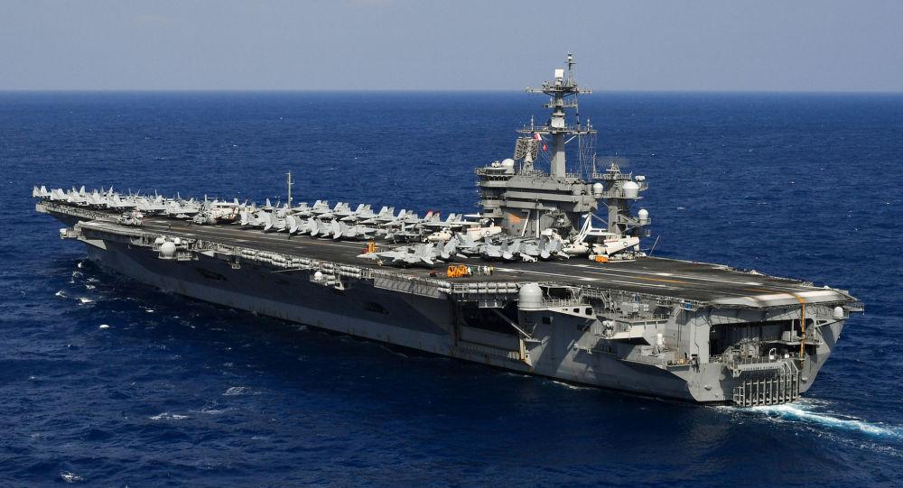 Peking avizoval vojenská cvičení v Jihočínském moři. Učinil tak poté, co vstoupila do regionu americká letadlová loď