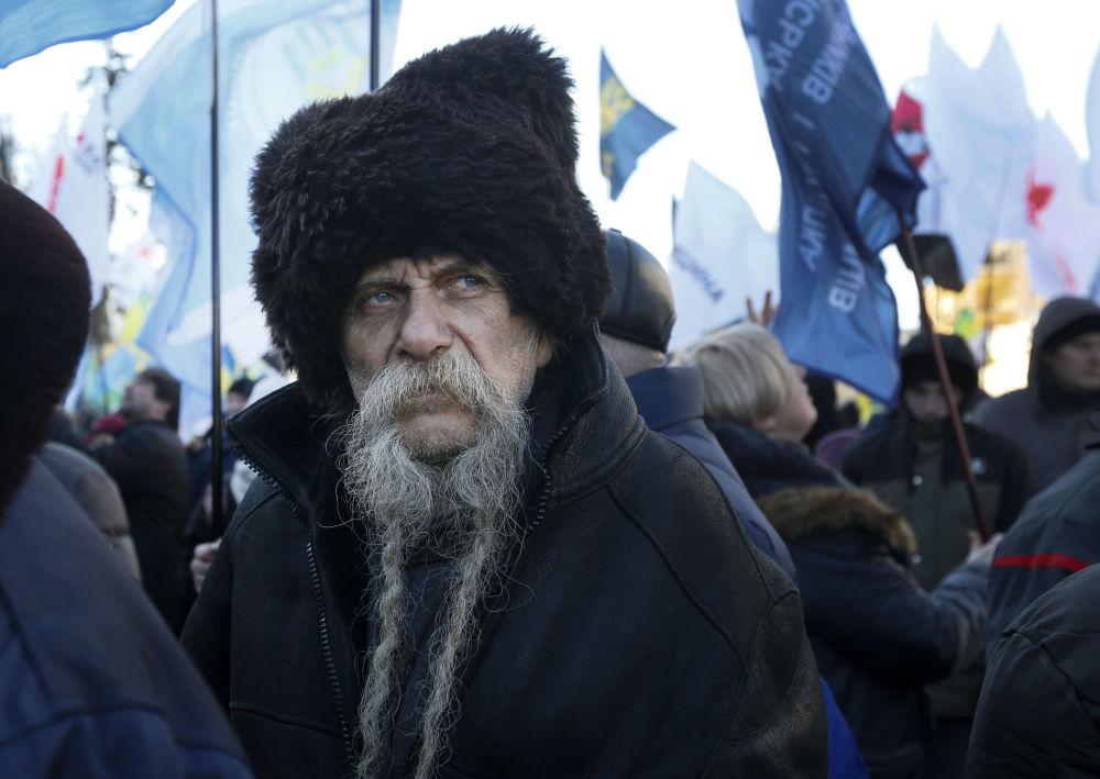 Účastník protestů proti legislativě o prodeji zemědělské půdy, 6 února 2020. Kyjev, Ukrajina