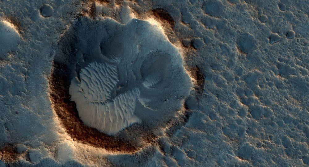 Fotografie planiny Acidalia Planitia na povrchu Marsu, v níž se odehrává děj filmu Marťan
