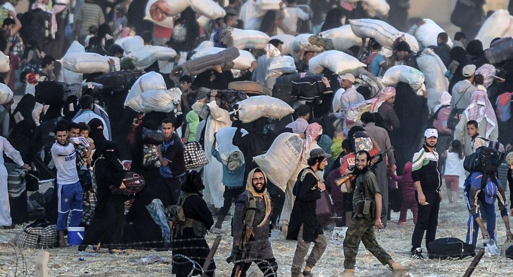 Syrští běženci na syrsko-turecké hranici