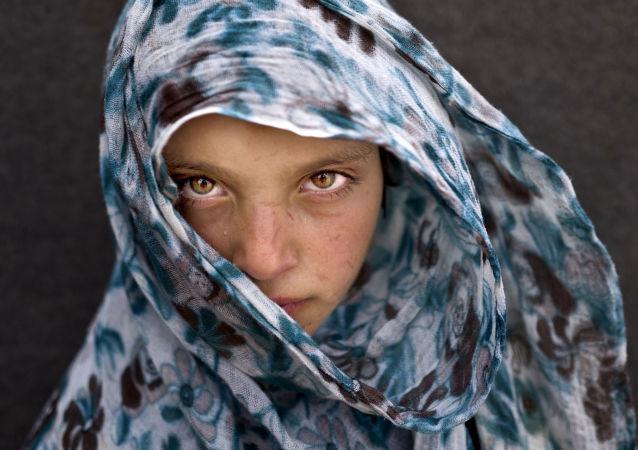 Mladá syrská uprchlice ve stanovém táboře v Jordánsku