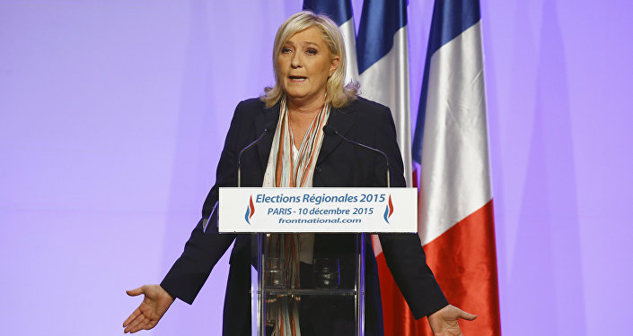 French far-right National Front Party leader, Marine Le Pen delivers a speech during a meeting in Paris, France, Thursday, Dec. 10, 2015.
