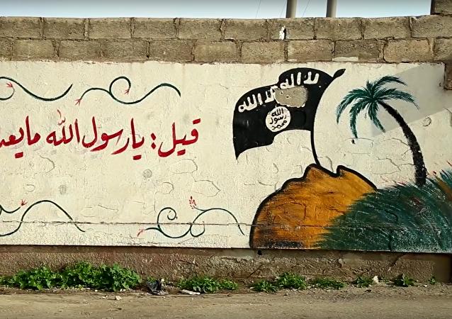 Graffiti s vlajkou IS
