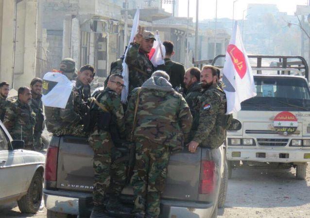 Syrští vojáci ve východním Aleppu