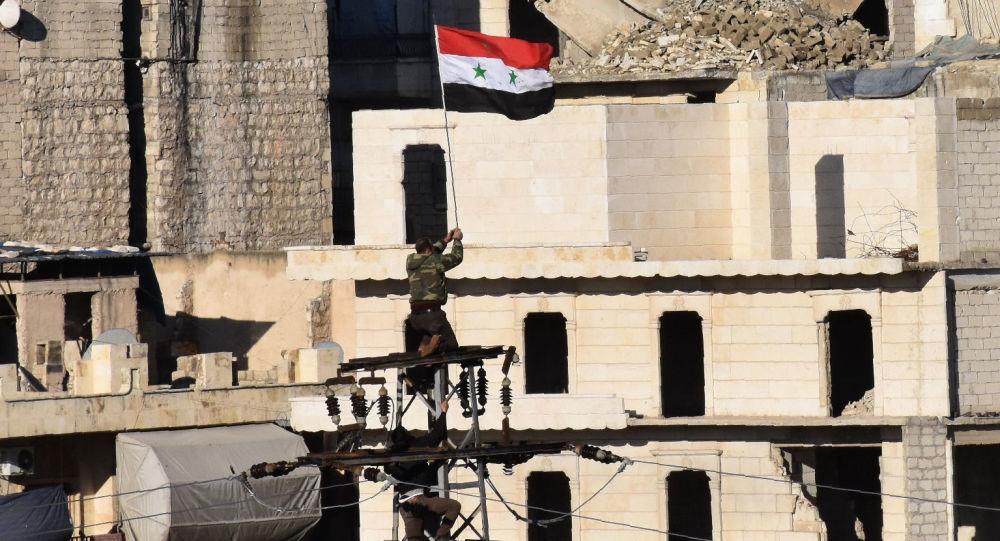Syrská vlajka nad Aleppem