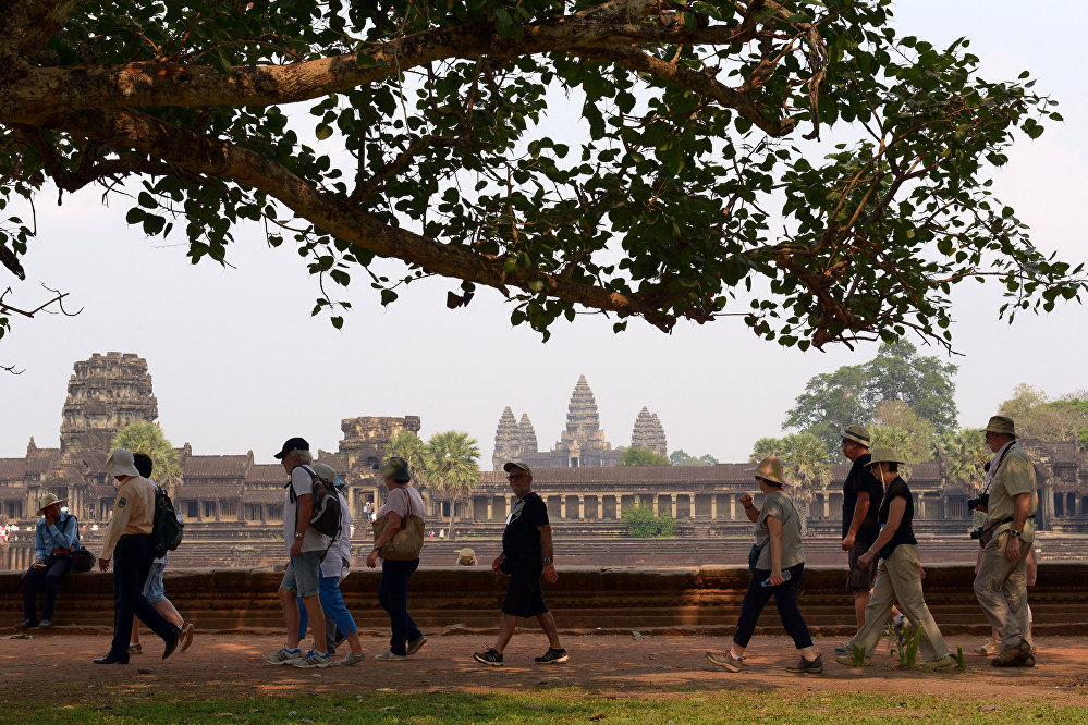 Tourists visit the Angkor Wat temple in Siem Reap province on March 20, 2015