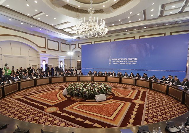 Delegations of Russia, Iran and Turkey hold talks on Syrian peace at a hotel in Astana, Kazakhstan, Monday, Jan. 23, 2017
