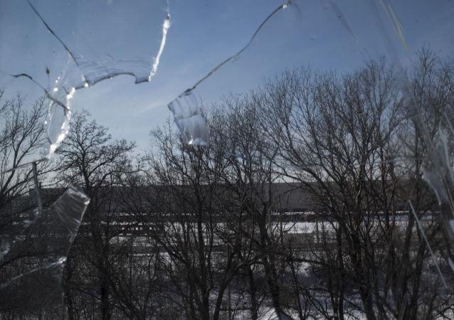 Rozbité okno v Doněcku