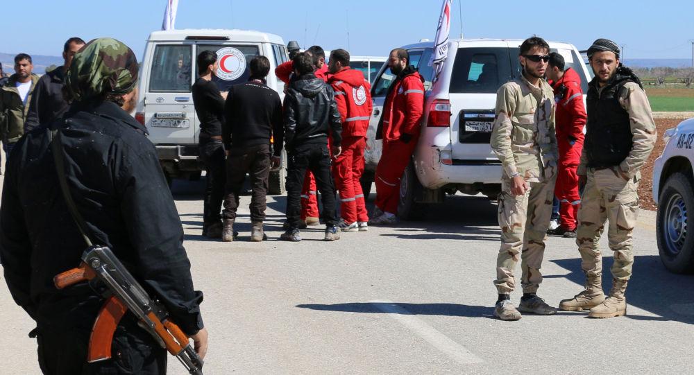 Odchod ozbrojenců z předměstí Homsu