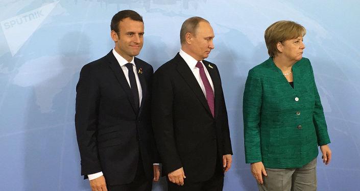 Schůzka ruského prezidenta Vladimira Putina s německou kancléřkou Angelou Merkelovou a s prezidentem Francie Emmanuelem Macronem