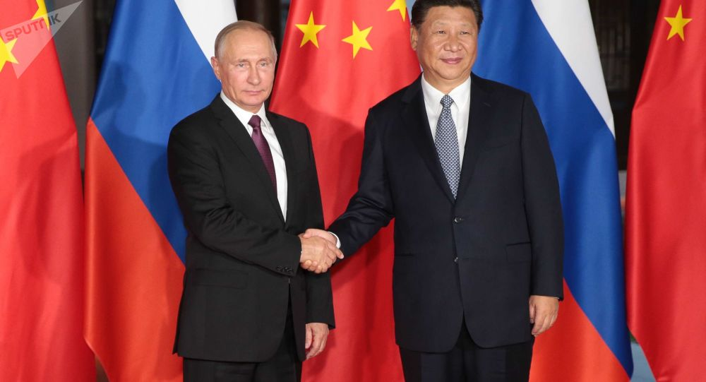 Vladimir Putin a  Si Ťin-pching