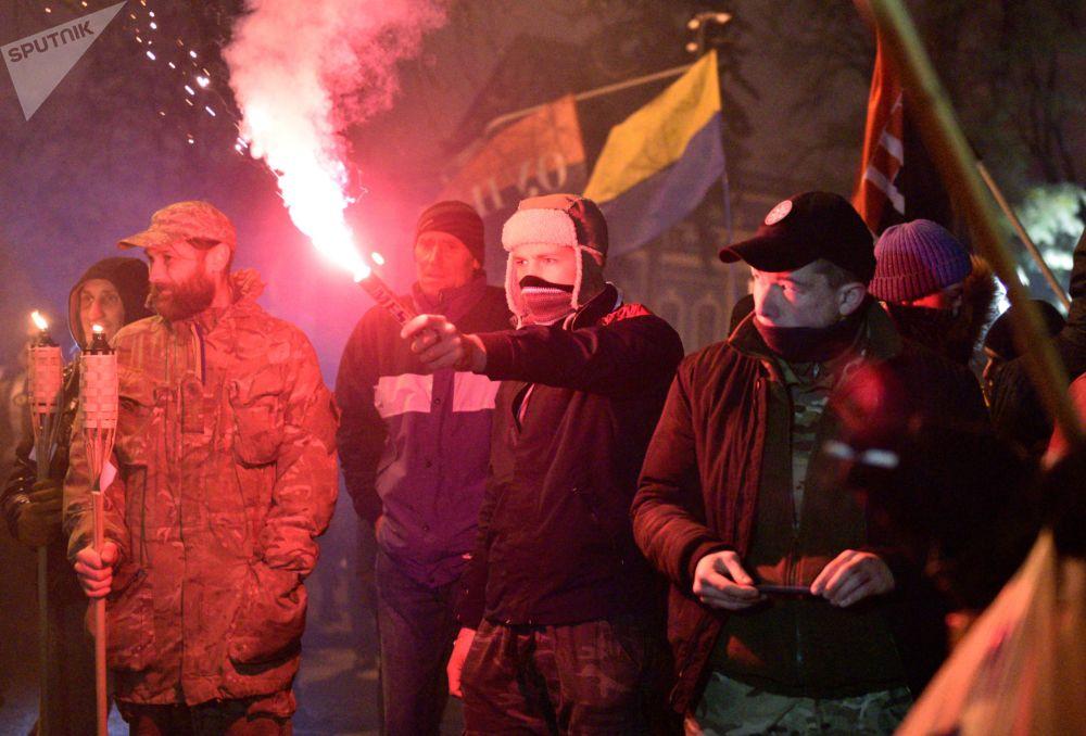 Účastníci pochodu v Kyjevě u příležitosti výročí zahájení událostí na Majdanu
