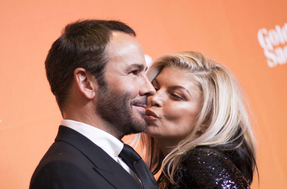 Designér Tom Ford a zpěvačka Fergie na dobročinném večírku TrevorLIVE v Los Angeles, USA