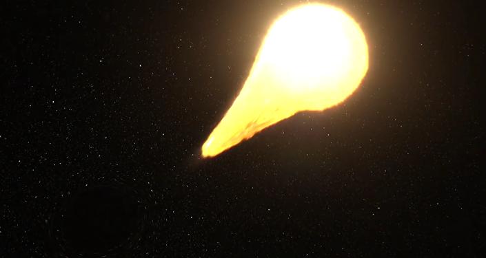Černá díra trhá hvězdu na kusy
