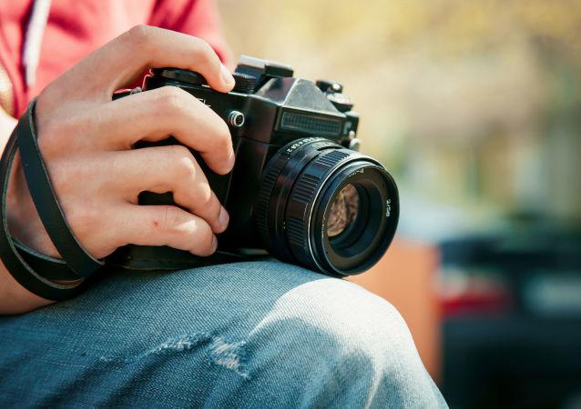Fotograf s fotoaparátem