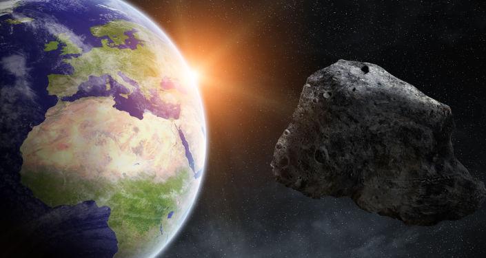 Астероид на фоне Земли