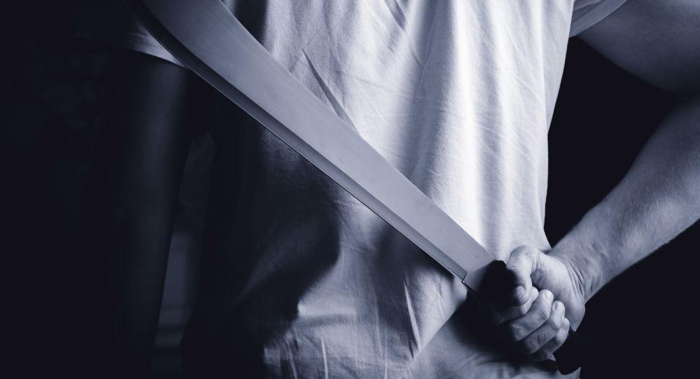 Muž s mačetou. Ilustrační foto
