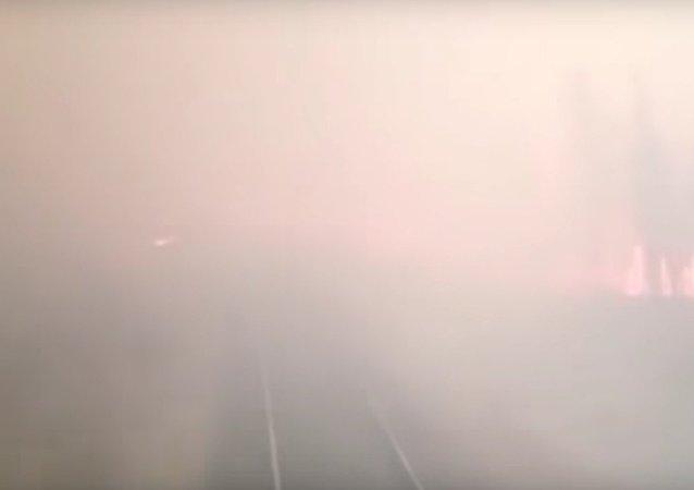 Ruský vlak projel přes lesní požár