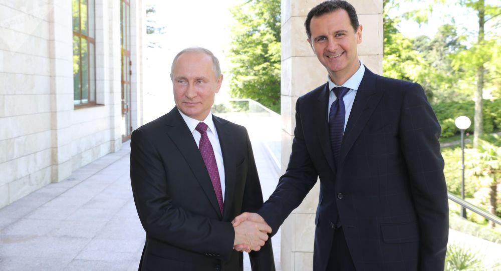 Vladimir Putin při setkání s Bašárem Asadem v Soči