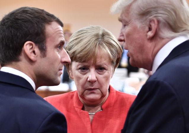 Francouzský prezident Emmanuel Macron, německá kancléřka Angela Merkelová a prezident USA Donald Trump