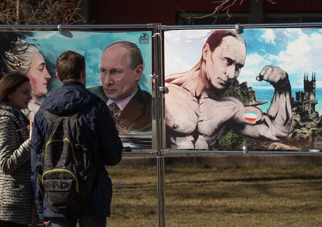 Obrázky Vladimira Putina na výstavě věnované Krymskému jaru