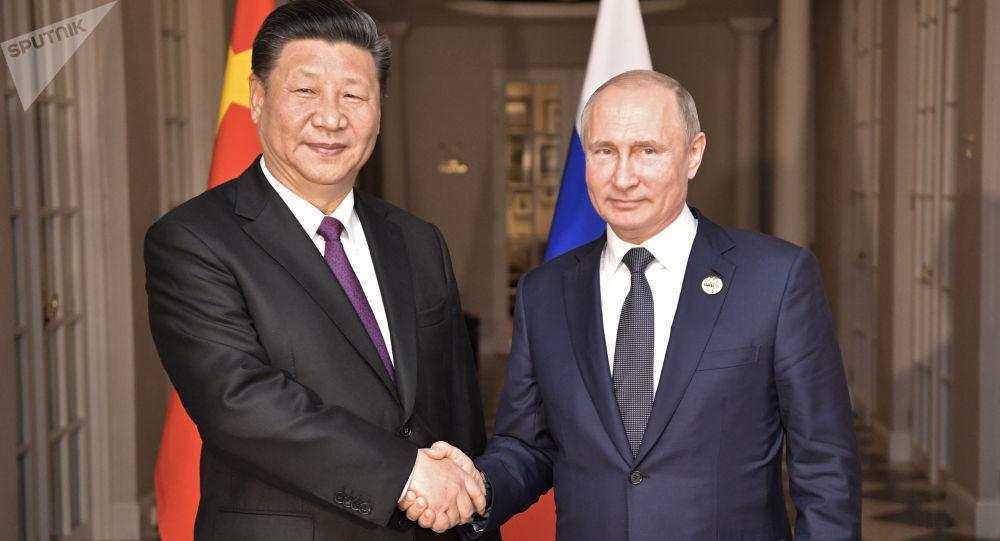 Čínský prezident Si Ťin-pching a jeho ruský protějšek Vladimir Putin