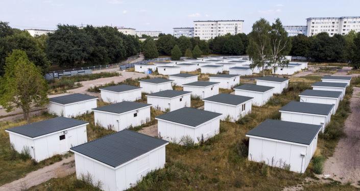 Domy uprchlíků, které se prodávají v Hamburku