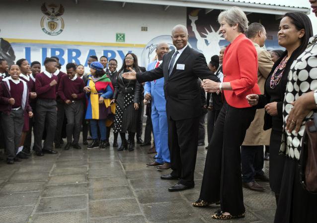 Theresa Mayová v Jižní Africe