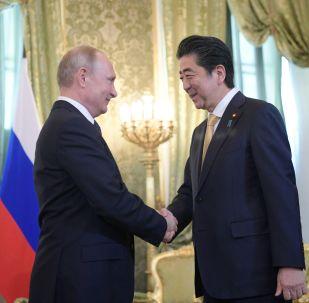 Ruský prezident Vladimir Putin a japonský premiér Šinzó Abe