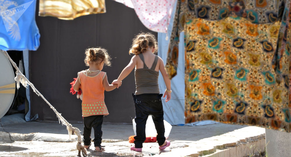 Děti v uprchlickém táboře v Latákii