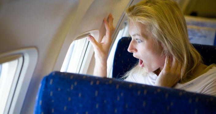 Žena v letadle