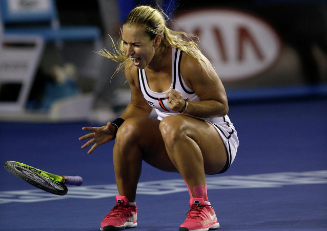 Dominika Cibulkova of Slovakia celebrates after defeating Victoria Azarenka of Belarus in their fourth round match at the Australian Open tennis championship in Melbourne, Australia