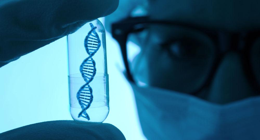 Vědec s modelem DNA ve zkumavce