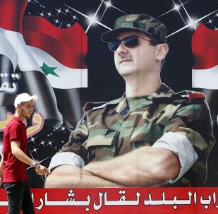 Plakát syrského prezidenta Bašára Asada v Damašku