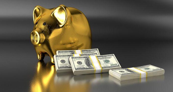 Zlatá pokladnička s dolary