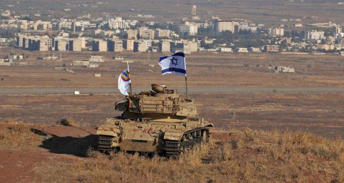 Izraelská vlajka na území Golanských výšin, které jsou pod kontrolou Izraele